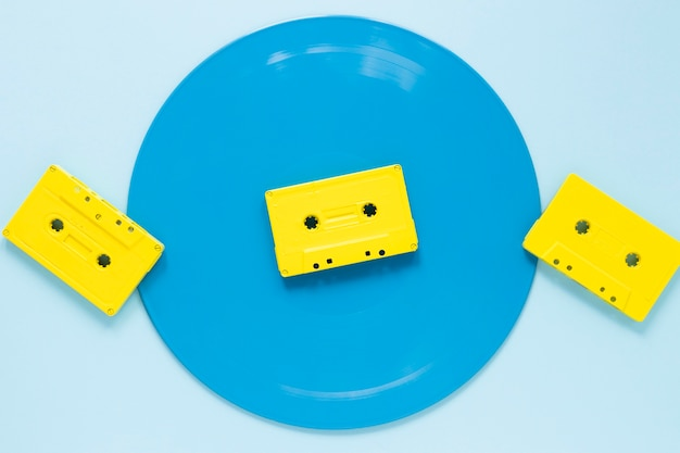 Flat lay audio cassettes with blue background