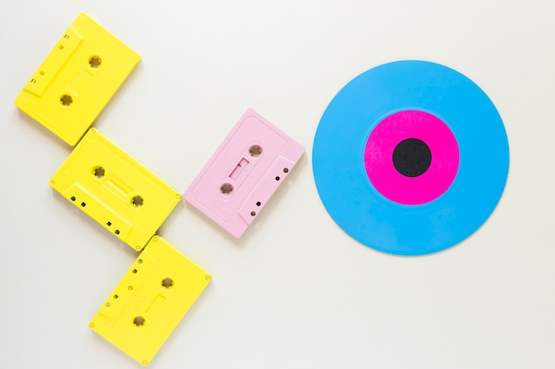 Flat lay audio cassettes with a vinyl disc
