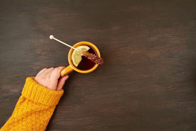 Flat lay autumn composition with tea and a warm woolen sweater