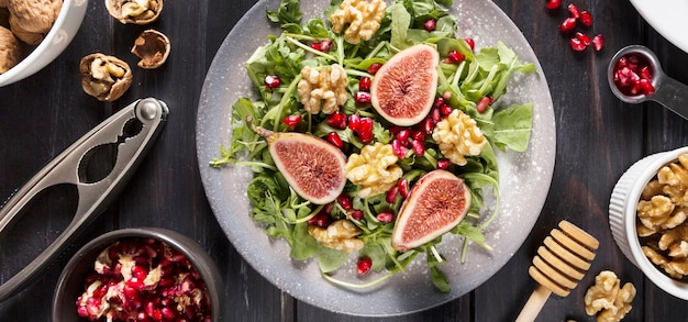 Flat lay of autumn fig salad with walnuts