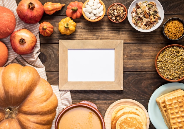 Flat lay autumn food on striped sheet with frame