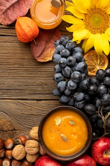 Flat lay autumn fruit and pumpkin soup