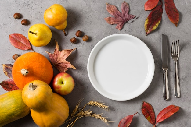Flat lay autumn harvest with plate