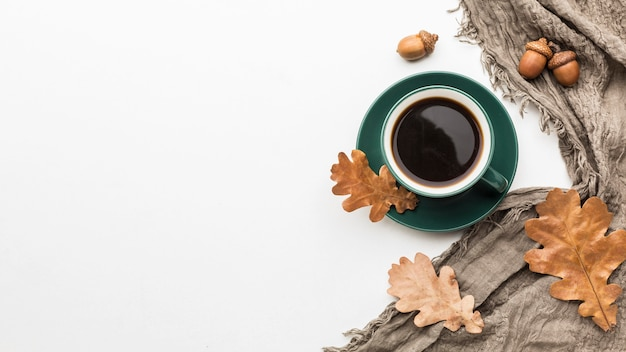 Flat lay of autumn leaves with coffee cup and copy space