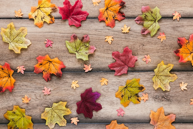 Flat lay autumn leaves on wooden table