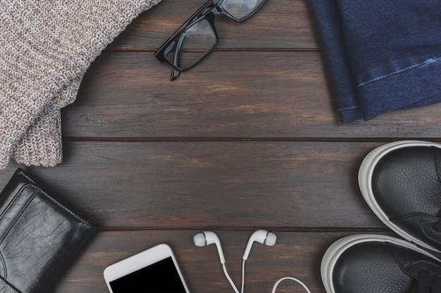 Flat lay of autumn or winter cloth and accessory on table with copy space