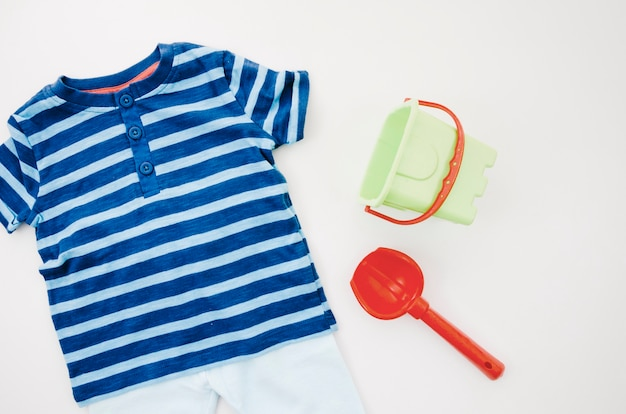 Flat lay baby clothes with toys