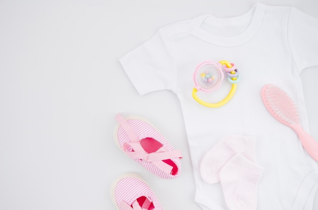 Flat lay baby clothes with white background