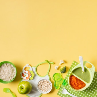 Flat lay baby food on yellow background