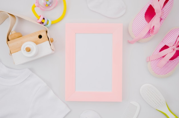 Flat lay baby shoes with frame