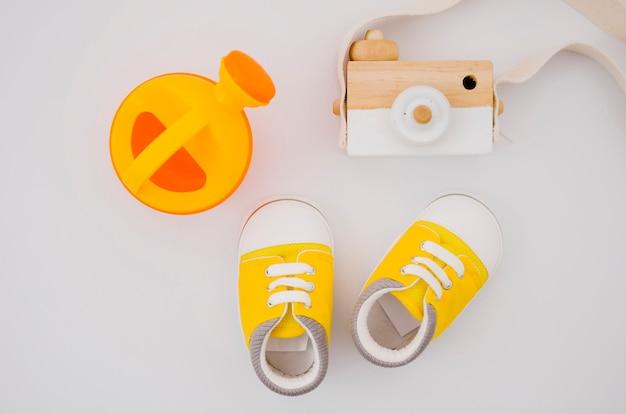 Flat lay baby shoes with white background