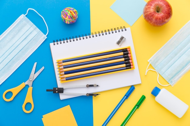 Flat lay of back to school materials with pencils and scissors