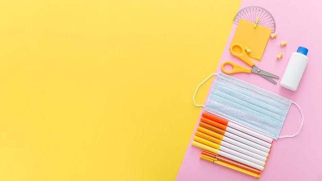 Flat lay of back to school supplies with copy space and scissors