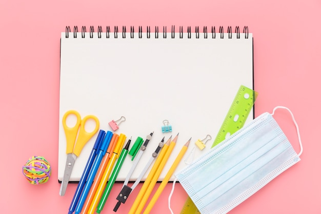 Flat lay of back to school supplies with notebook and pencils