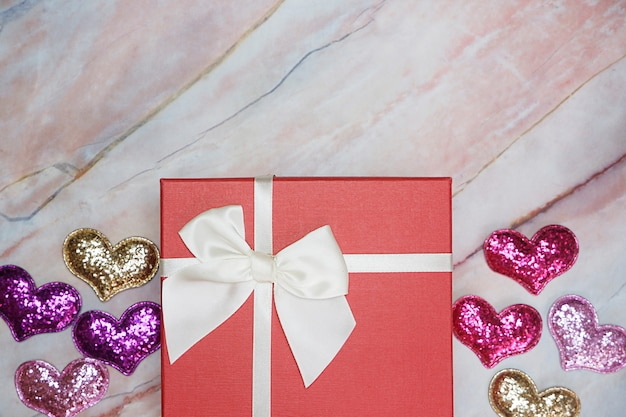 Flat-lay background for valentine's day, love, hearts, gift box copy space