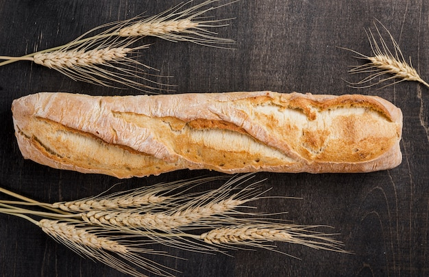 Flat lay baguette french bread with wheat
