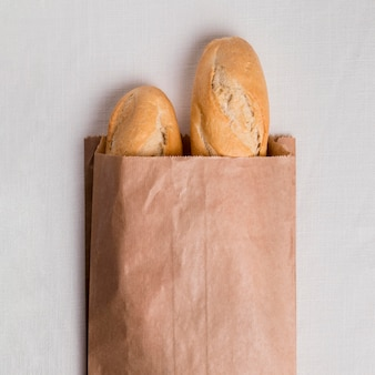 Flat lay baguettes in paper packaging
