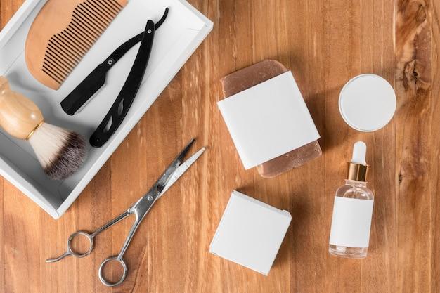 Strumenti e olio del negozio di barbiere piatto laici