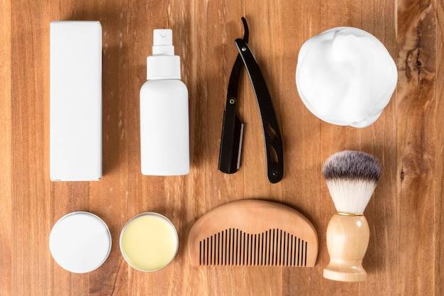 Flat lay barber shop tools on wooden background