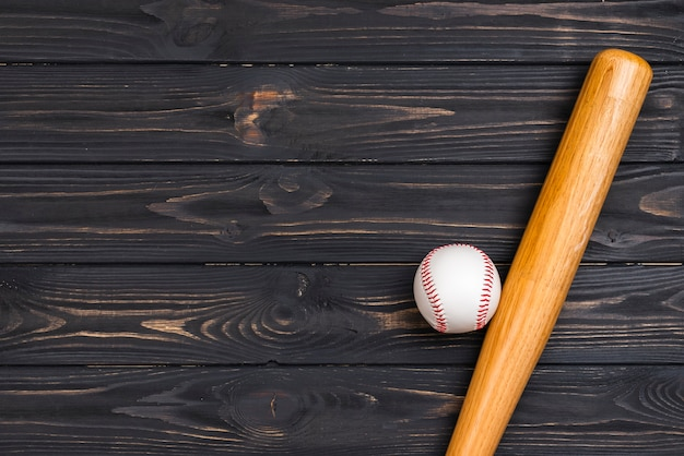 Flat lay of baseball bat and ball
