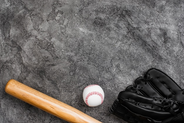 Flat lay of baseball bat and glove