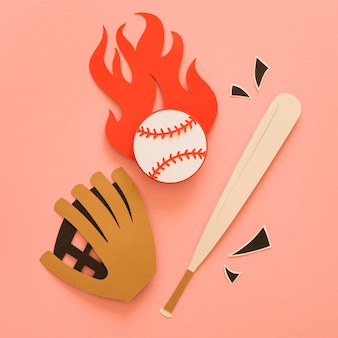 Flat lay of baseball bat with glove and ball