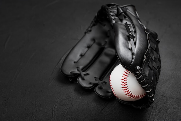 Flat lay of baseball inside glove
