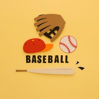 Flat lay of baseball with bat, glove and cap