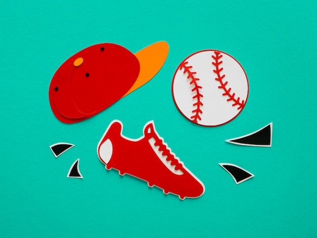 Flat lay of baseball with cap and sneaker