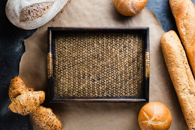 Flat lay of basket and bread on baking sheet