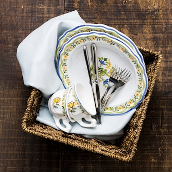 Flat lay basket with floral tableware