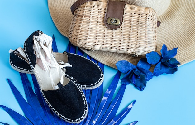 Flat lay of beach women's accessories.