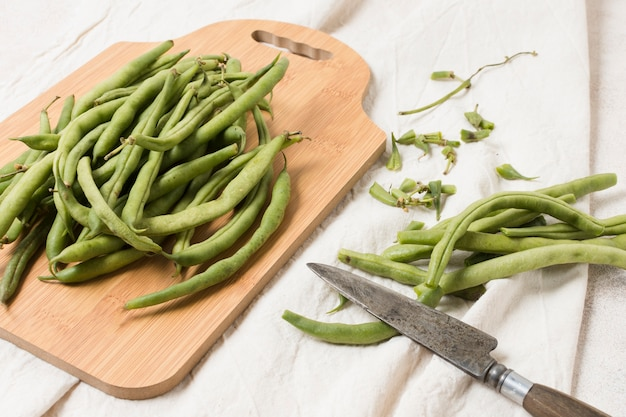 Flat lay of beans on chopping board