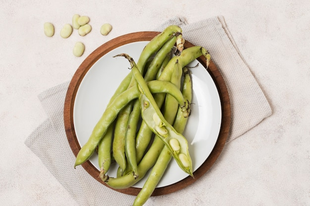 Flat lay of beans and garlic on plate