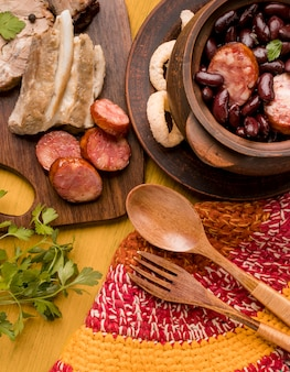 Flat lay beans and sausages dish
