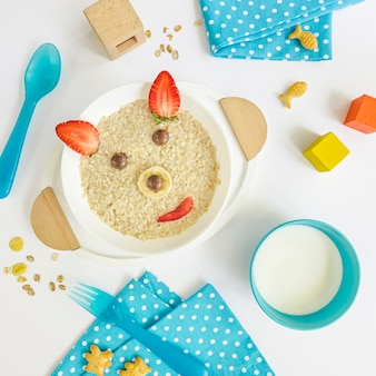 Flat lay bear shape cereals and fruits