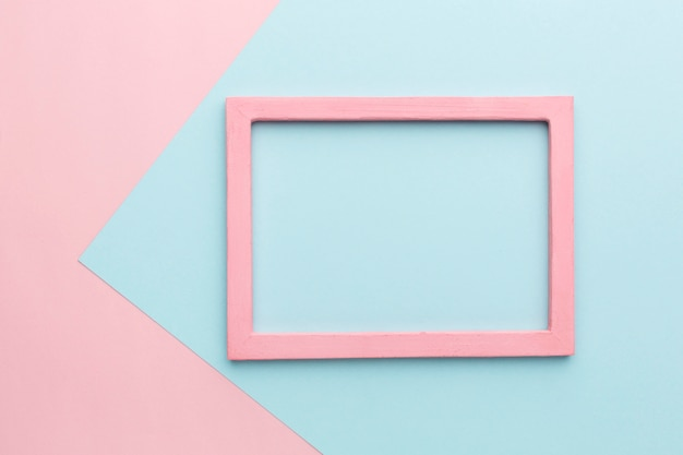 Flat lay of beautiful pink wooden frame concept