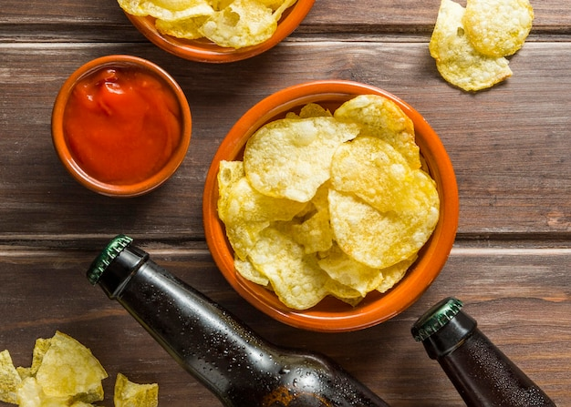 Flat lay of beer bottles with chips
