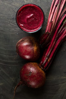 Flat lay beets with beet juice glass