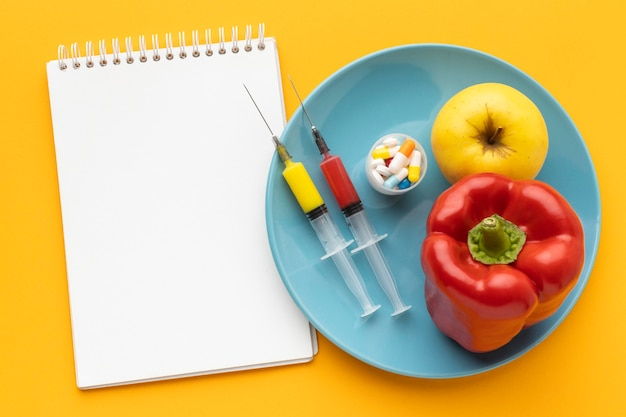 Flat lay bell pepper and apple copy space