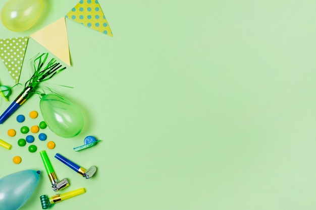 Flat lay birthday decoration on green background with copy space