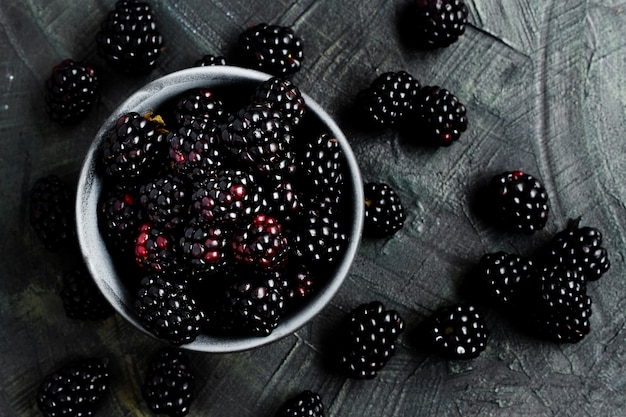 Flat lay black forest fruits in bowl