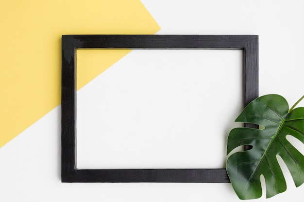 Flat lay of black frame with copy space