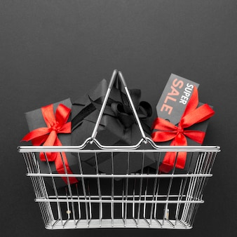 Flat lay black friday assortment on black background with copy space