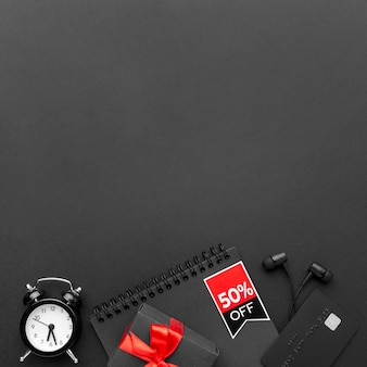 Flat lay black friday elements on black background with copy space