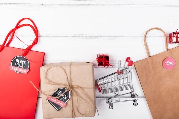 Flat lay black friday gifts and shopping cart