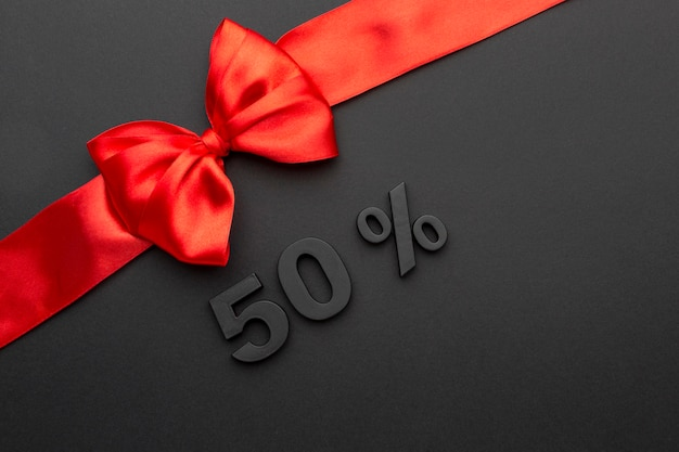 Flat lay black friday red ribbon with copy space
