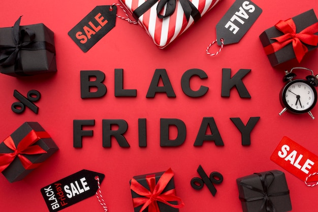 Flat lay black friday sales arrangement on red background