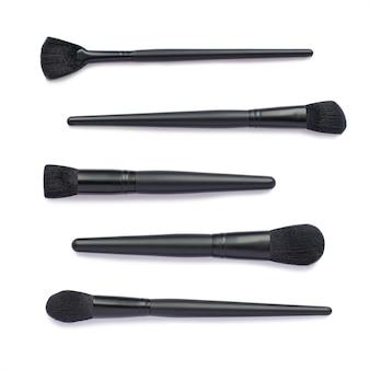 Flat lay of black makeup brushes set