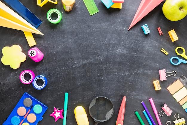 Flat lay of blackboard and school tools